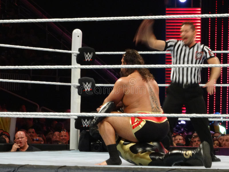 Rusev applies the Accolade on GoldDust as ref shout for him to r. SAN JOSE - MARCH 30: Rusev applies the Accolade on GoldDust as ref shout for him to release royalty free stock photo