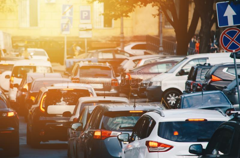 Rush hour in the city. Many cars on the road in the traffic jam at rush hour at the sunset on the street royalty free stock photos