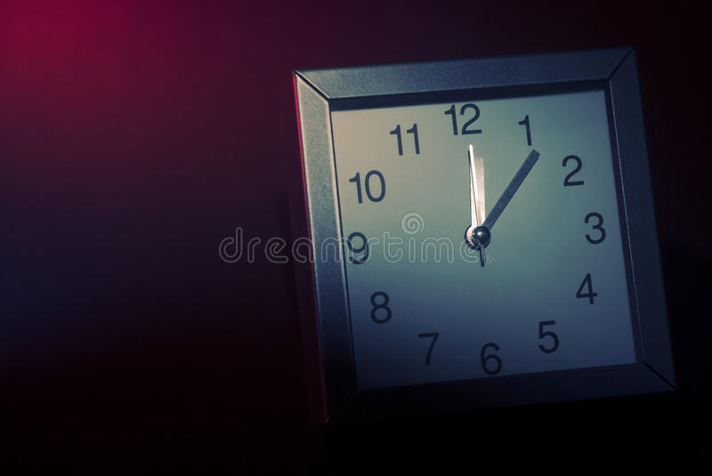 Rush hour clock. Clock on red background. Rush and late metaphoric scene royalty free stock image