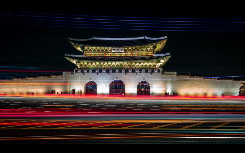 Rush hour in front of Gwanghwamun Gate. Long exposure shot during rush hour in front of Gwanghwamun Gate in Seoul, South Korea stock images
