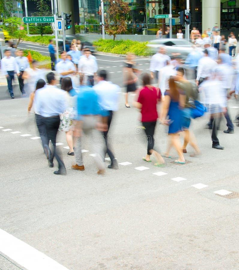 Rush hour, people at crosswalk stock images