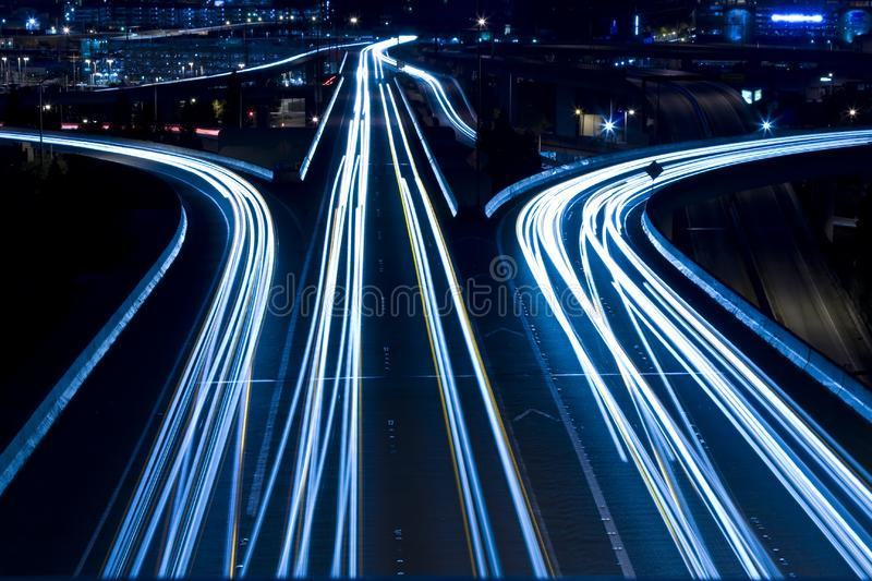 Rush hour traffic. A shot of rush hour traffic on a bridge in blue tone stock photos
