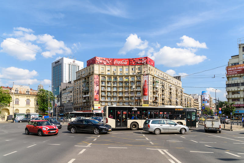 Rush Hour Traffic In Downtown Roman Square (Piata Romana) Of Bucharest. BUCHAREST, ROMANIA - MAY 11, 2016: Rush Hour Traffic In Downtown Roman Square (Piata royalty free stock images