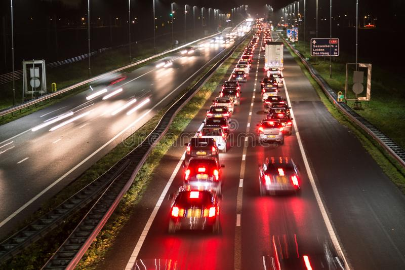 Busy highway traffic with light trails stock images