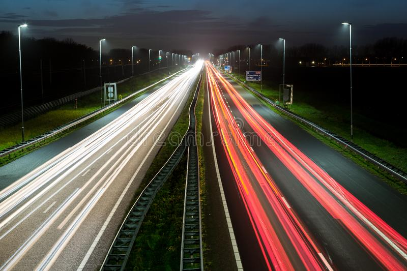 Highway traffic rush hour with light trails stock image