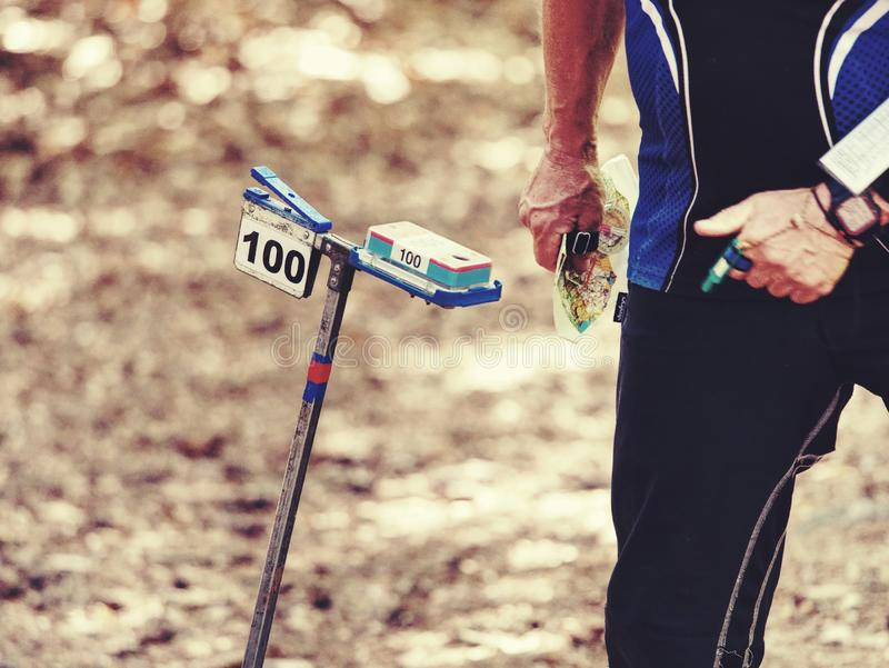 Rush sport people  in forest checking chip with control point stock photography