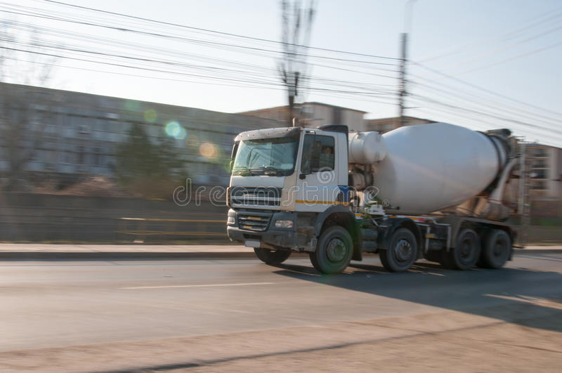 Rushing cement truck. Cement truck on the way to the building site royalty free stock image
