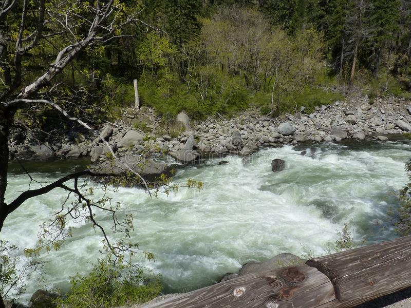 Rushing mountain waters stock photo