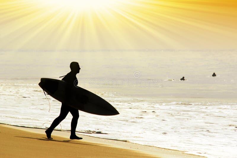 Rushing surfer stock image