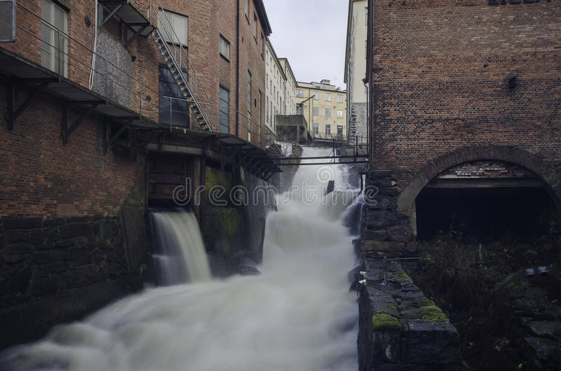 Rushing water free falling down from the top royalty free stock photography
