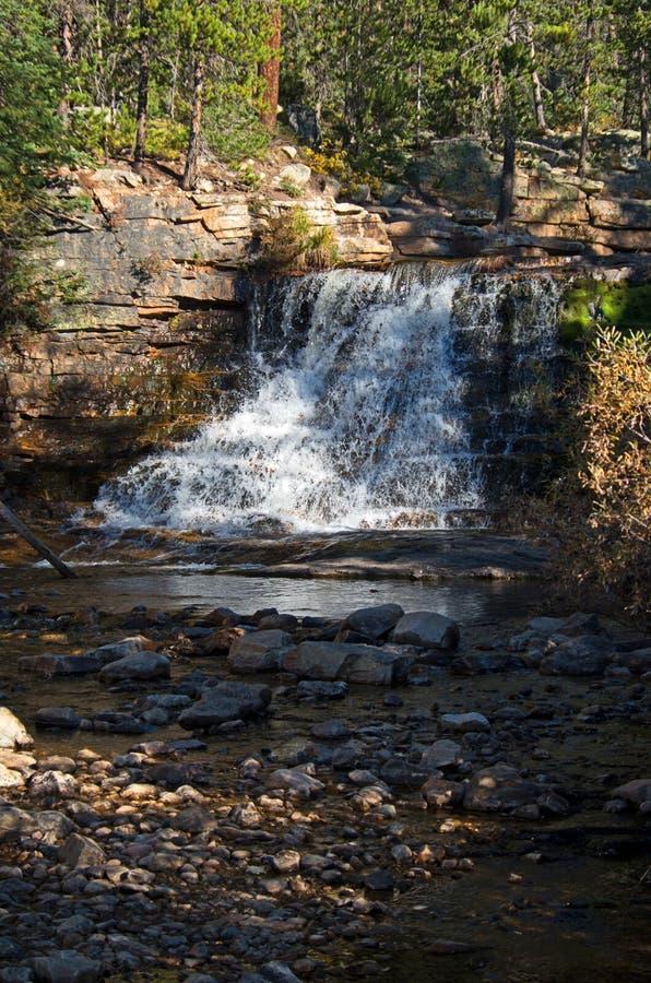 Rushing water. Rushing mountain stream cascading over rocks stock photos