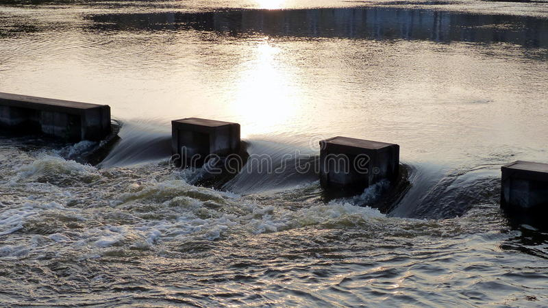 Rushing Water. Water from a river gushes into an over-flow area of a dam royalty free stock photography