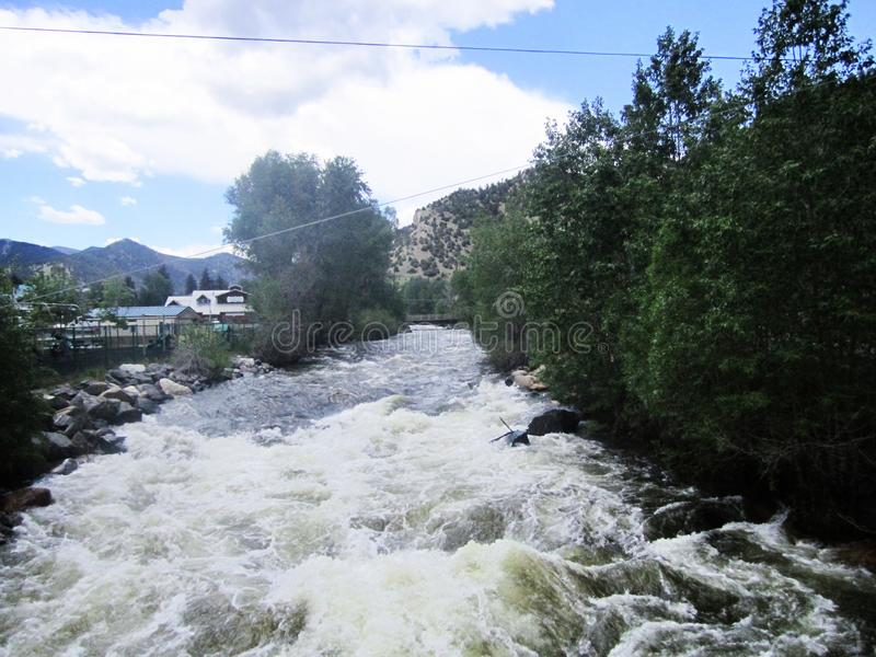 Rushing White Waters Of Falls River in Idaho Springs, Colorado. White waters of Falls River rushing through Idaho Springs, Colorado royalty free stock images