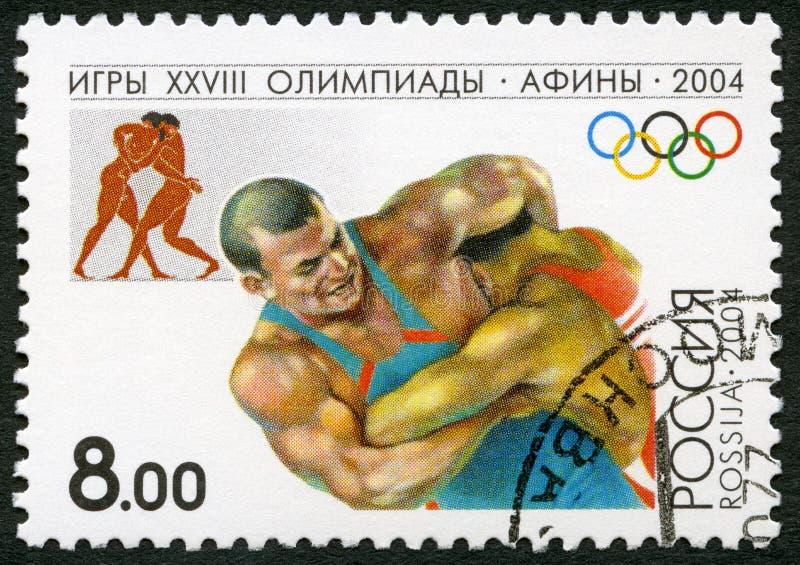 RUSIA - 2004: demostraciones que luchan, serie 2004 Olimpiadas de los juegos del verano, Atenas foto de archivo