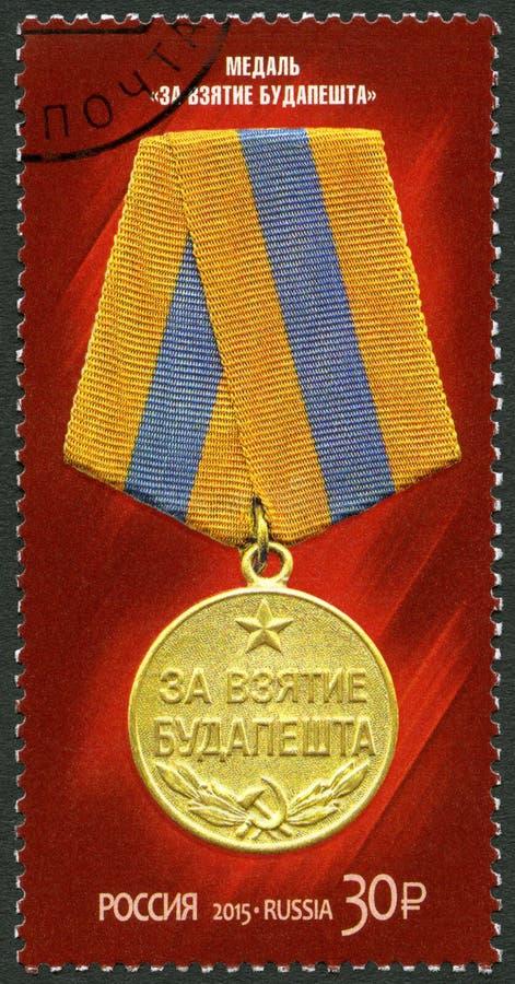 RUSIA - 2015: medalla de las demostraciones para la captura de Budapest, serie el 70.o aniversario de la victoria en la gran guer foto de archivo libre de regalías