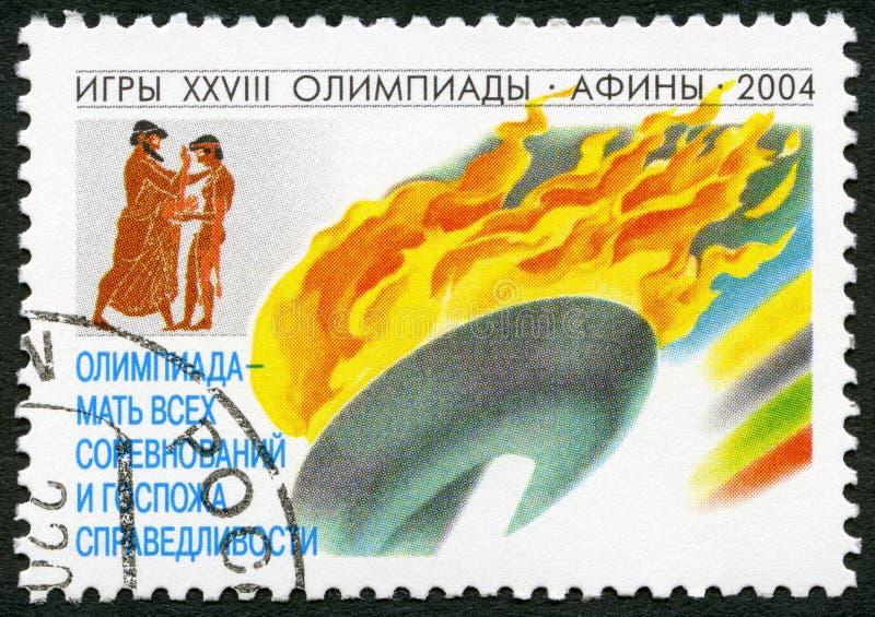 RUSIA - 2004: muestra la llama olímpica, serie 2004 Olimpiadas de los juegos del verano foto de archivo
