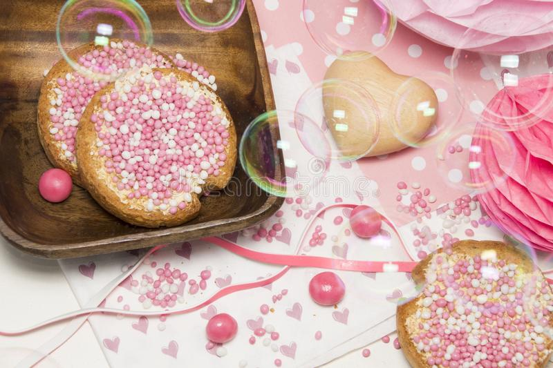 Rusk with blue aniseed balls, muisjes, tradition in the Netherlands when a baby girl is born royalty free stock image