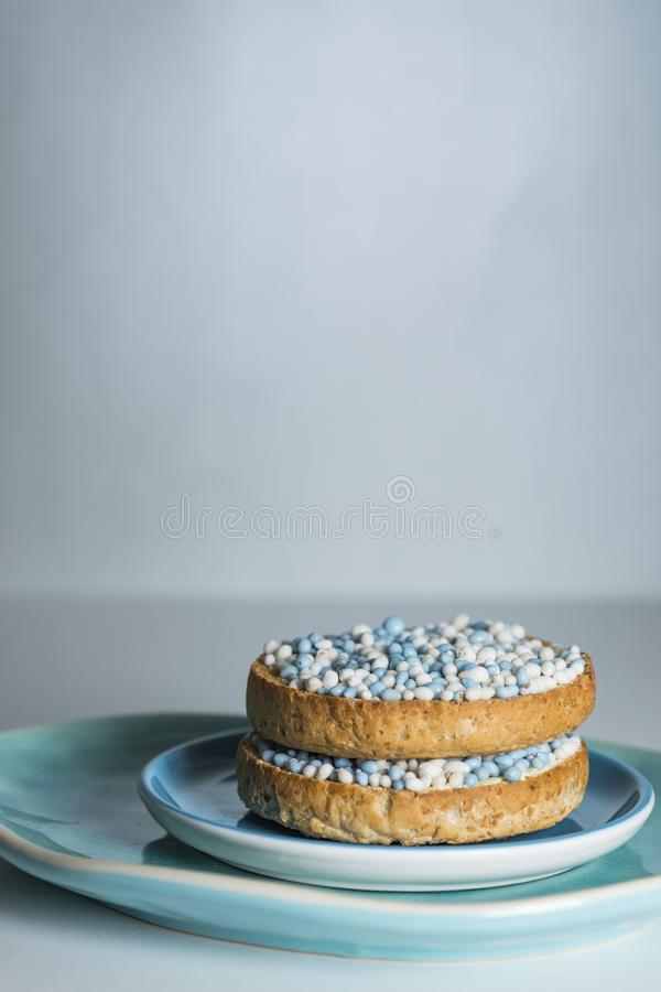 Rusk with blue aniseed balls, muisjes, tradition in the Netherlands to celebrate the birth of a son. Close up rusk with blue aniseed balls, muisjes. Tradition in stock image