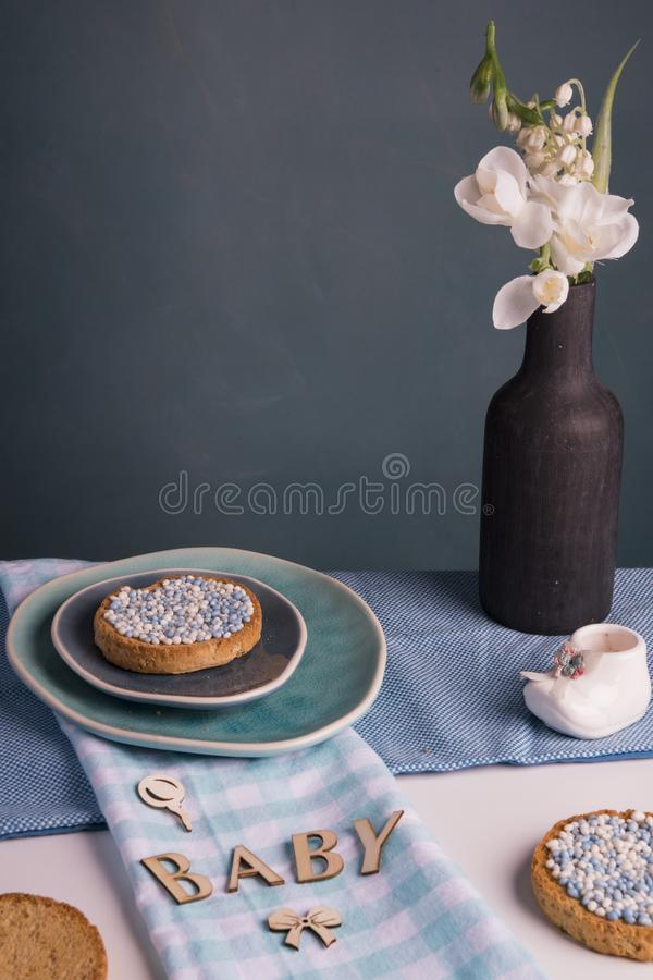 Rusk with blue aniseed balls, muisjes, tradition in the Netherlands to celebrate the birth of a son. Morning scene with flowers, rusk with blue aniseed balls royalty free stock images