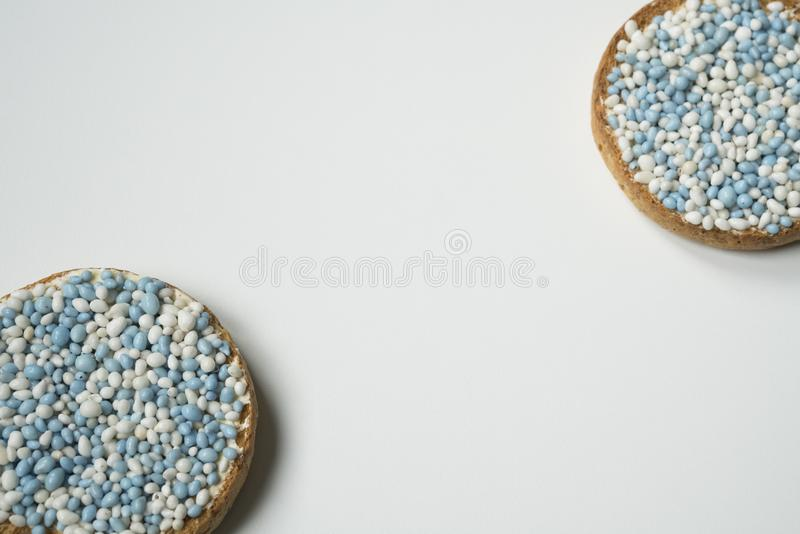 Rusk with blue aniseed balls, muisjes, tradition in the Netherlands to celebrate the birth of a son. Rusk with blue aniseed balls, muisjes. Tradition in The royalty free stock photos