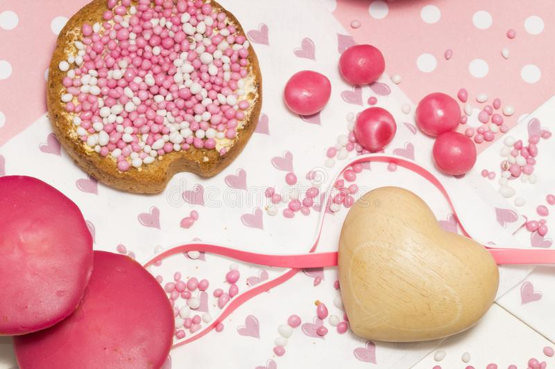 Rusk with pink aniseed balls, Dutch muisjes, Dutch treat to when a baby girl is born. Rusk with pink white aniseed sprinkles. Dutch muisjes. Typical treat in The stock photos