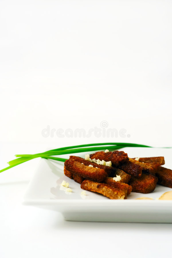 Rusk with spring onion. Rusk with garlic and spring onion royalty free stock images