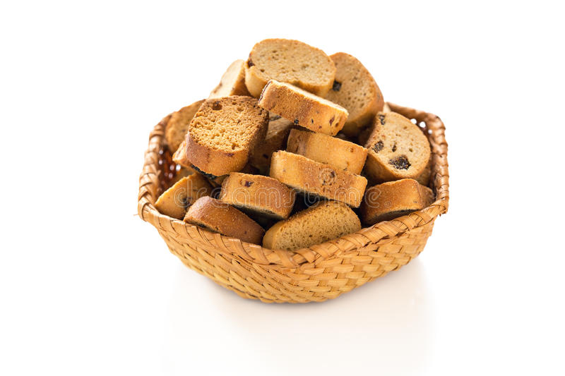 Rusks with raisins in a wicker basket. royalty free stock photo