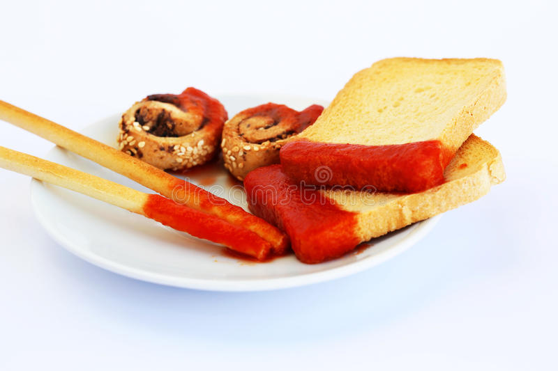 Rusks with sesame seeds, bread sticks and sauce royalty free stock photo