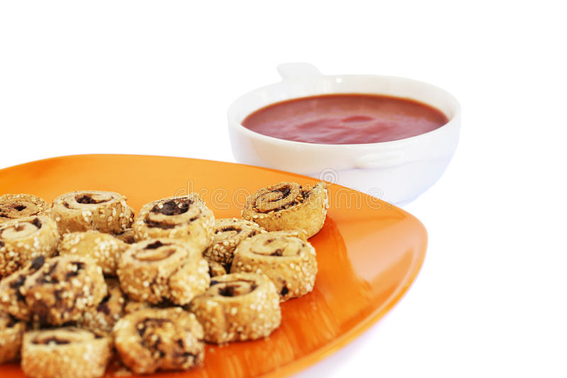 Rusks with sesame seeds, olives and sauce royalty free stock photo