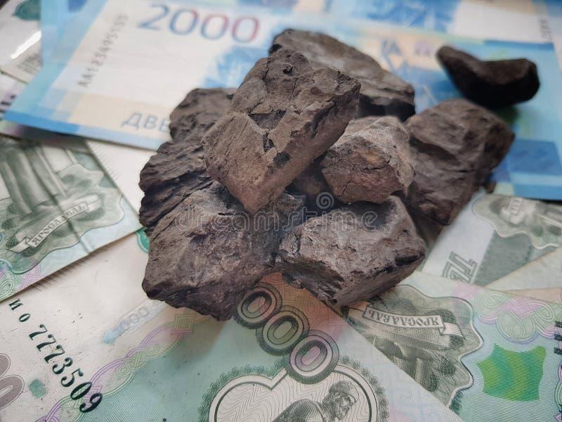 Rusland heeft het belangrijkste inkomen van de verkoop van wereldwijd uitgevoerde steenkool stock afbeeldingen