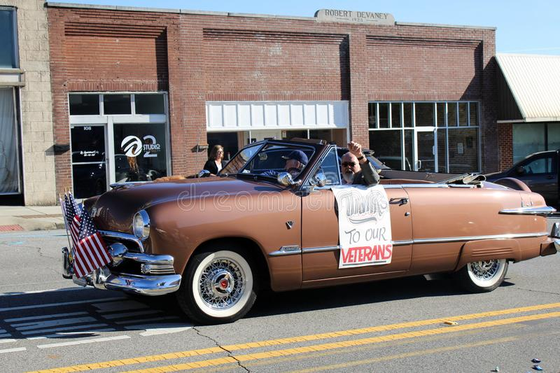 Russellville 1950s Brown car in Veteran`s Day Parade. Russellville, Alabama, United States November 10, 2019  Russellville 1950s brown car, Thanks to Our royalty free stock photography