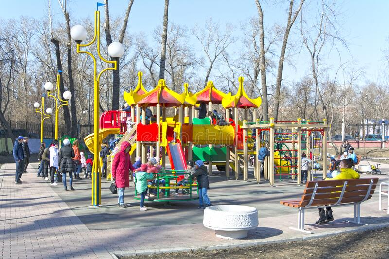Russia. Abakan. Children play in the children`s town, in the municipal park. Spring 2019 royalty free stock photos