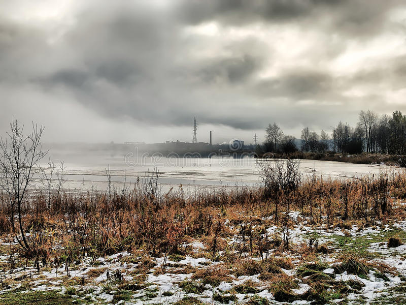 Russia - Arkhangelsk - frozen suburb lake at foggy winter day stock photography