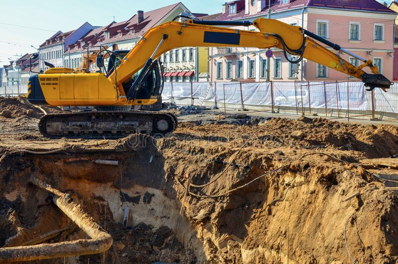 Excavator work at Construction Site. Yellow Excavator work at Construction Site stock images