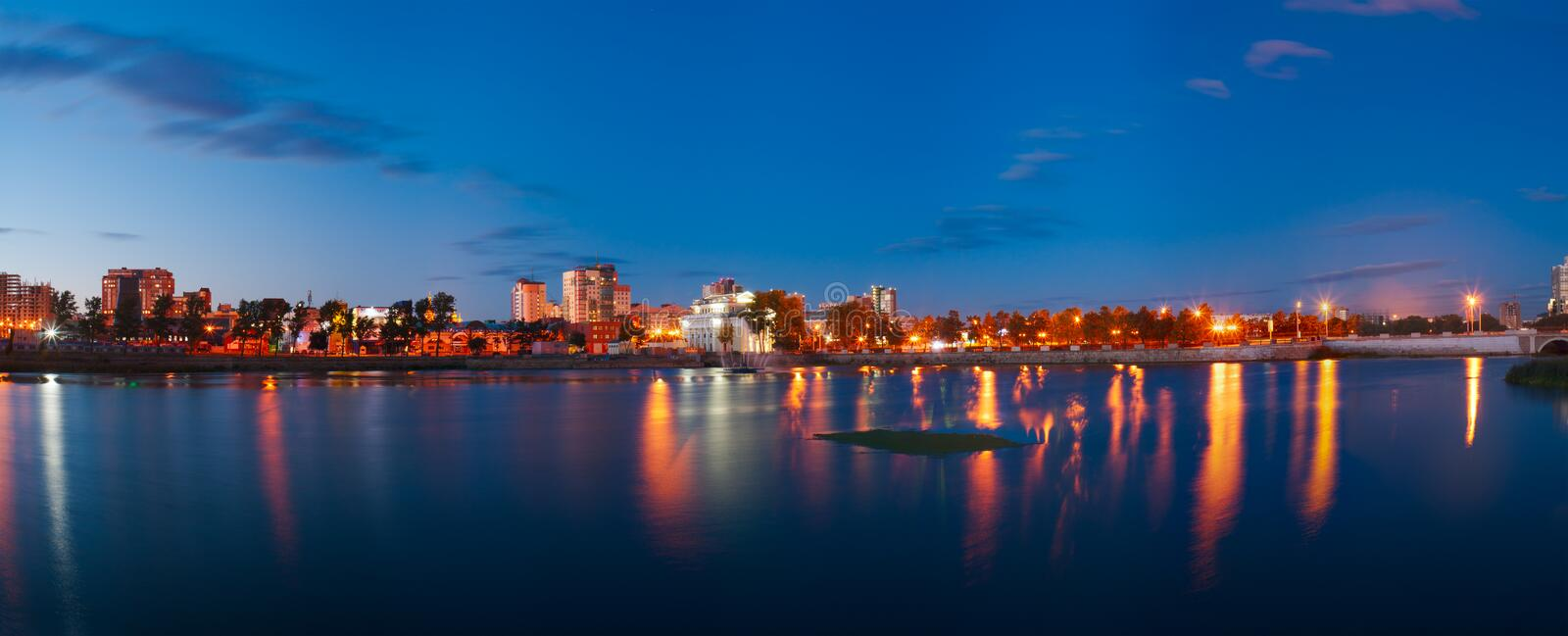 Evening panorama of the Miass River embankment, Chelyabinsk, September 2017. Editorial use only. Russia, Chelyabinsk - September 2017: Evening panorama of the stock images