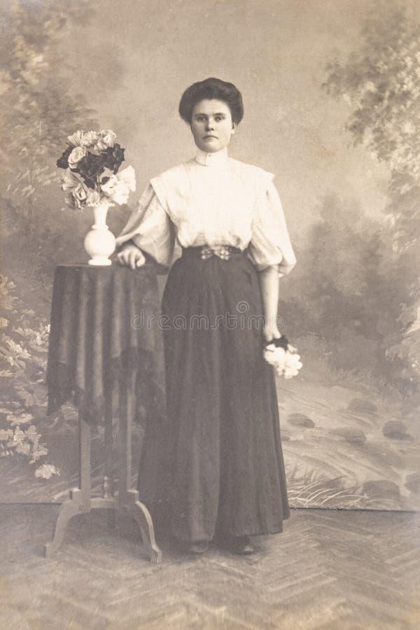 RUSSIA - CIRCA 1905-1910: A portrait of young woman in studio, Vintage Carte de Viste Edwardian era photo stock images