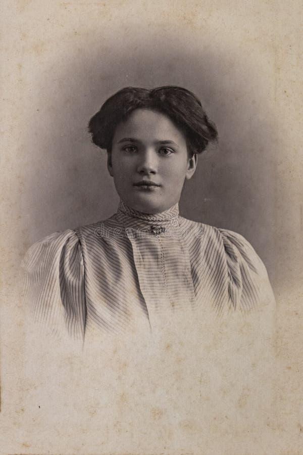 RUSSIA - CIRCA 1905-1910: A portrait of young woman, Vintage Carte de Viste Edwardian era photo royalty free stock images