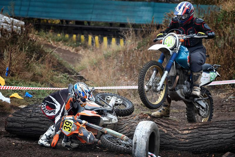 Russia, city of Magnitogorsk, - October, 7, 2011. Participants in races on motorcycles over rough terrain at an open city stadium. Motocross - speed and sight royalty free stock photo