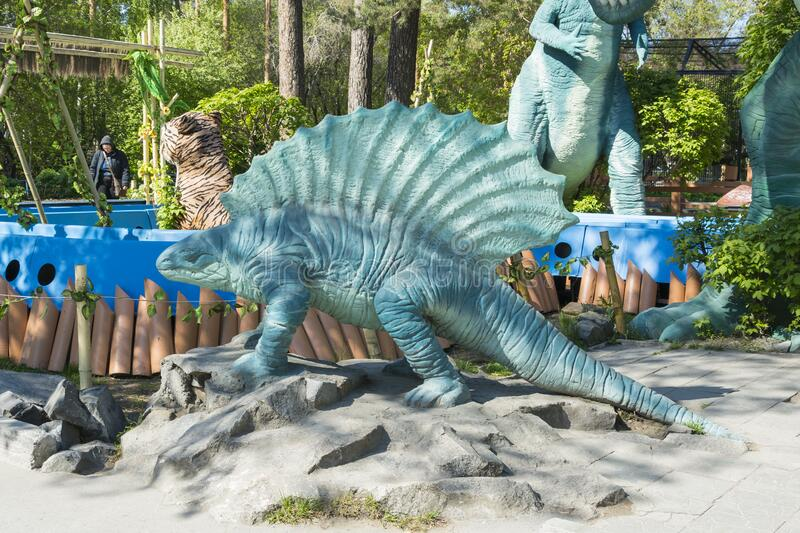 Zoo  Extinct animals. Russia, the city of Novosibirsk, the zoo on May 21, 2014. A statue of a dinosaur. Extinct animals stock photos