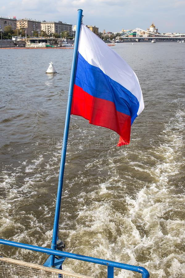 Russia flag and Moskva River and embankments stock photography