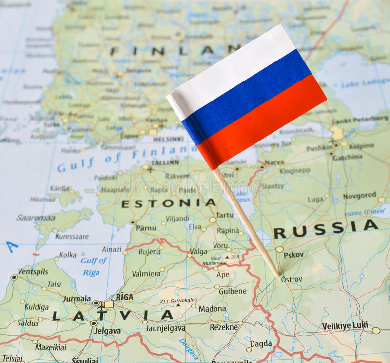 Russia flag pin on map. Closeup shot of Russia flag pin on map bordering with the Baltic countries stock images