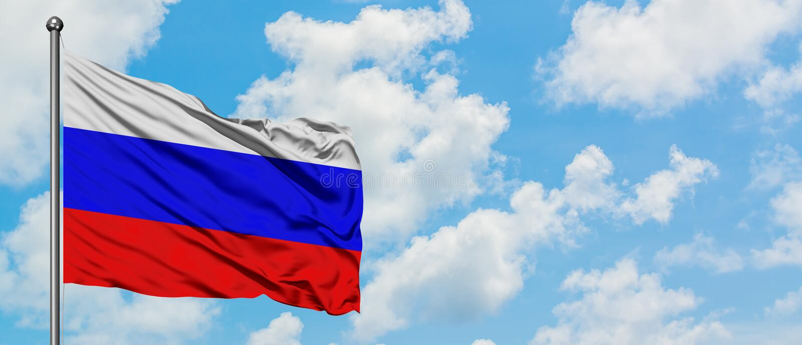 Russia flag waving in the wind against white cloudy blue sky. Diplomacy concept, international relations.  royalty free stock images