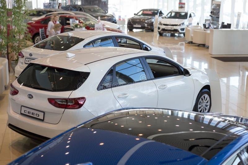 Russia, Izhevsk - April 4, 2019: New cars in the KIA showroom. Famous world brand. Prestigious vehicles stock photography