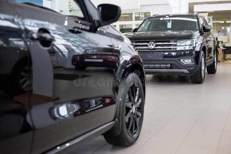 Russia, Izhevsk - February 15, 2019: Showroom Volkswagen. New cars in dealer showroom. Modern transportation royalty free stock image