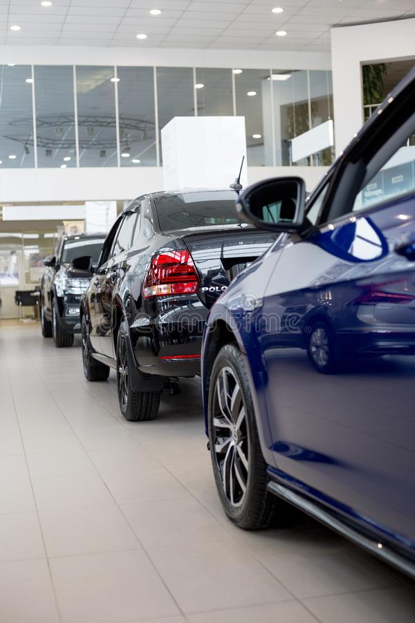 Russia, Izhevsk - February 15, 2019: Showroom Volkswagen. New modern cars in dealer showroom. Famous world brand royalty free stock photo
