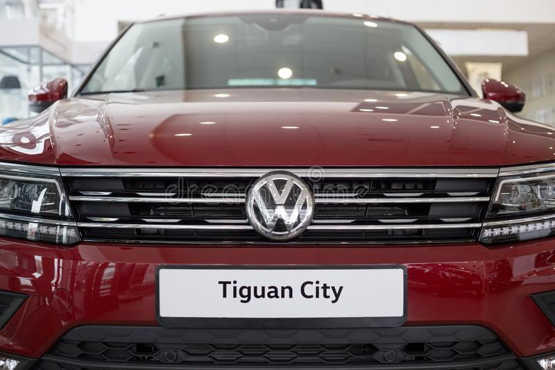 Russia, Izhevsk - February 15, 2019: Showroom Volkswagen. New Tiguan in dealer showroom. Famous world brand royalty free stock photo