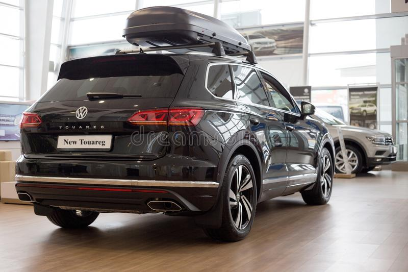 Russia, Izhevsk - February 15, 2019: Showroom Volkswagen. New Touareg in dealer showroom. Famous world brand stock photo
