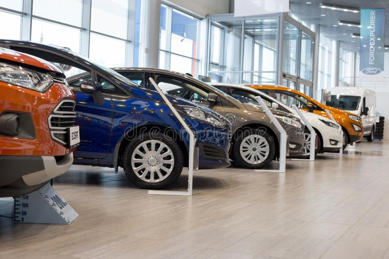 Russia, Izhevsk - January 27, 2019: Showroom Ford. New cars in dealer showroom. Modern transportation. The famous world brand was founded by Henry Ford on 1903 royalty free stock image