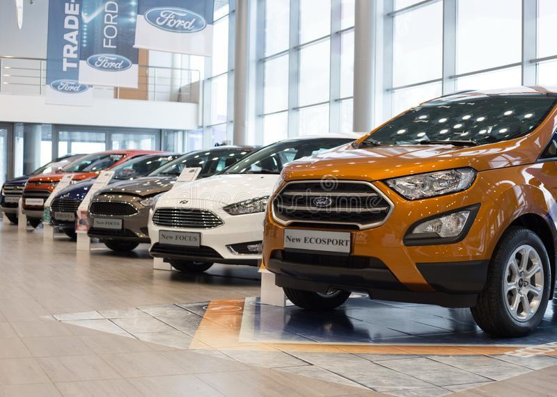 Russia, Izhevsk - January 27, 2019: Showroom Ford. New cars in dealer showroom. Modern transportation. The famous world brand was founded by Henry Ford on 1903 stock photos