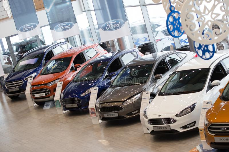 Russia, Izhevsk - January 27, 2019: Showroom Ford. New cars in dealer showroom. Modern transportation. Prestigious vehicles royalty free stock photos